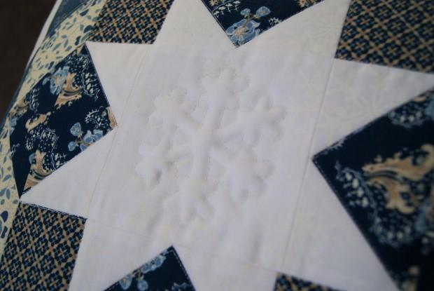 Snowflake Trapunto Pillow featuring